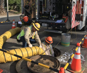 LADWP crews working to repair damaged cable on Commonwealth Avenue to restore power to apartment building behind them.