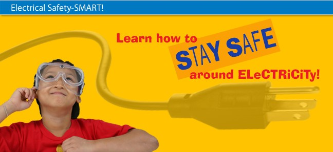Image of a kid wearing safety goggles in a red shirt that says learn how to stay safe around electricity