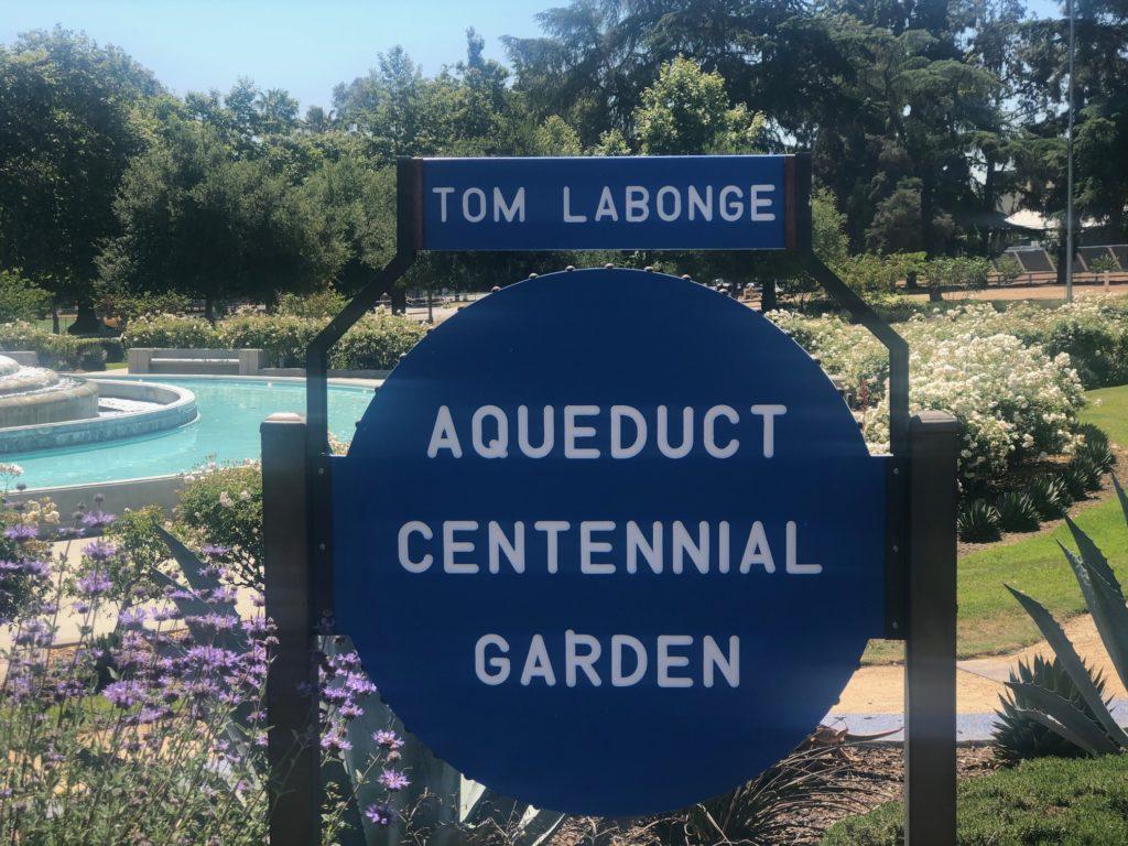 Image of a sign that reads Tom Labonge Aqueduct Centennial Garden